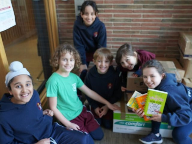 Highgate School junior pupils taking part in the Children's Book Project charity donation of pre-loved titles
