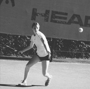 Year 10 Highgate pupil Jess playing tennis